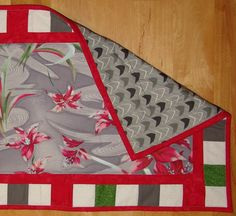 Christmas reversible runner featuring retro grey and poinsettia fabric with a green, red, white border.  Modern grey, black, white back. by EmilHansDesigns on Etsy