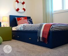 Nautical Navy, Red and Green Boy's Room in Maine Stream Synergy 2 Show Room for Hopewell Residential.By Wise Home + Design