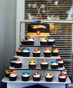 Hot Wheels Party!! put a real hot wheels car on each cupcake for the kids to take!!! LOVE!