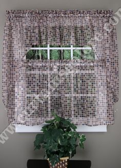 Tiles curtains have a multi colored textured glass tiles in an all over grid pattern printed on a contemporary styled sheer voile.  #Sheer #Kitchen #Curtains