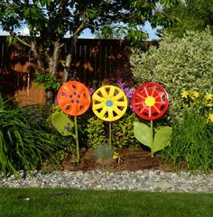 Hubcap Flower Garden. If you get even more creative with paint you can make them resemble actual flowers in your garden. (Saw this done in the Birds and Blooms Feb/March 2013 issue - can't find a photo online)
