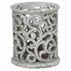 """Bring an eye-catching pop of style to your coffee table or mantel with this artful ceramic candleholder, featuring a scrolling openwork design highlighted by antiqued detailing.   Product: CandleholderConstruction Material: CeramicColor: CementFeatures: Scrolling openwork designAccommodates: (1) Candle - not includedDimensions: 7.5"""" H x 6.5"""" DiameterCleaning and Care: Wipe with damp cloth"""