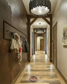 Hallway off the foyer with custom unique lighting fixtures.