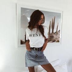 stylsih 80s 90s inspired outfit idea : denim skirt, white top and fishnet stockings look fashion and style instagram photo ispiration