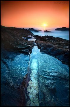 Stunning colors of blue mixing in with the yellow, orange and pink horizon of the setting sun. Look and you will find yourself there.
