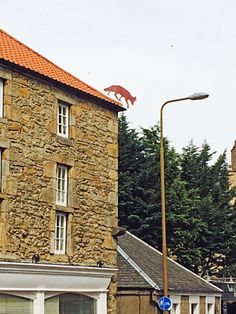 Fox ornament on roof ridge, Cannon Mills, Edinburgh. http://richardcoyne.com/2014/04/19/why-cartoons-have-animals-2/