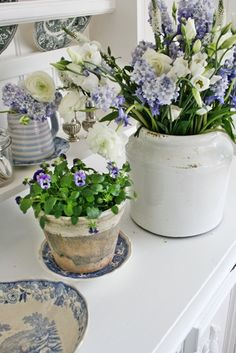 ...lovely idea...i could use broken teacup saucers underneath plants...