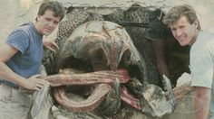 """Amalgamated Dynamics co-founders Tom Woodruff, Jr. and Alec Gillis flank one of their massive, worm-like """"Graboids"""" from TREMORS."""