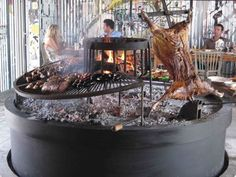 Estancia Vik (Jose Ignacio, Uruguay): traditional asado thanks to a striking barbeque pit in a room plastered in graffiti art Fire Grill, Bbq Grill, Outdoor Oven, Outdoor Cooking, Asado Grill, Gas Fire Pit Table, Fire Cooking, Smoker Cooking, Pig Roast