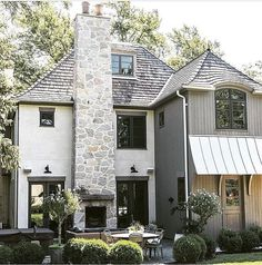 Love the mix of textures in the exterior design of this home as well as the landscape design.
