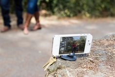 Tiltpod Mobile Tripod by photojojo: A keychain-sized go-anywhere ball head tripod with a grippy base for flat or uneven surfaces for the iPhone 4/4S. (Works in portraiat or landscape!)