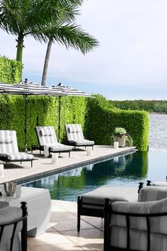 In a Florida house designed by Marshall Watson, Walters Wicker Castillo chaises are set against a wall of ficus near the pool. Click through through more pool designs and ideas for beautiful swimming pools. Outdoor Areas, Outdoor Rooms, Outdoor Living, Outdoor Furniture Sets, Outdoor Decor, Outdoor Patios, Outdoor Kitchens, Pool Furniture, Living Pool
