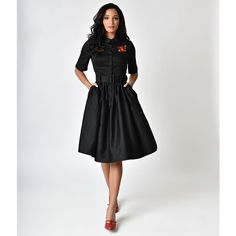 Collectif 1950s Style Black Rose Aria Swing Shirtdress (€75) ❤ liked on Polyvore featuring dresses, black, shirt dress, ruched shirt dress, half sleeve dresses, rosette dress and long shirt dress