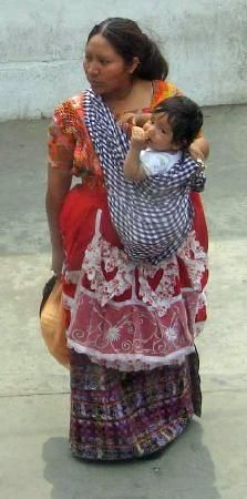 Guatemala: Traditional dress and ways to carry the baby.