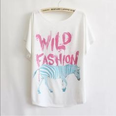 "Animal Print Tee New~Zebra Animal Print Tee New~Zebra Style- Loose Batwing Sleeve Length 25.98"" Bust: 43""-47"" Soft and Comfy Fit Smoke FREE Home No Tradefirm unless bundled Tops Tees - Short Sleeve"