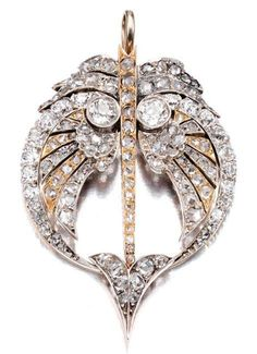 A diamond and gold brooch, circa late-19th century. Designed as a winged arrow, set throughout with cushion-shaped, rose- and circular-cut diamonds, detachable brooch fitting.