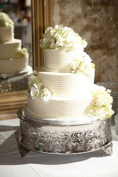 white line surfaced cake with white flowers