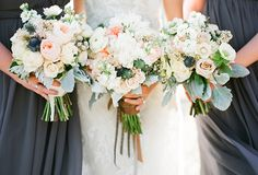 """Bridal bouquet: white peonies, white ranunculus, Juliet garden roses, thistle and white scabiosa flower accented by dusty miller. """"Gypsy Floral & Events did an incredible job bringing our vision to life. We wanted the flowers to accent and showcase the amazing venue in Round Top"""" Thanks to Southern Weddings Magazine for featuring this wedding! Gypsy Floral and Events 
