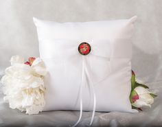 A beautiful white or ivory satin pillow provides the perfect resting place for wedding rings on their way to the alter. Keeping with the Military theme, a seal is affixed to an elegant organza bow. Choose from Air Force, Navy, Army, or Marines. $32.95