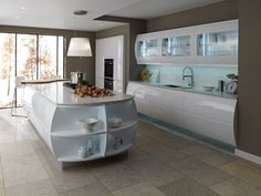 This #beautiful kitchen is our Remo range in #Gloss White with a stunning #barrell design island