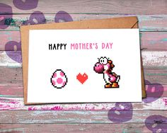 This is for all the mothers who you know you can't pause online video games  All our Mother's day cards are made with passion and a little touch of nerdy and geeky elements :) Are you looking for funny and geeky mothers day gift ideas? Check out our Etsy store for more nerdy mothers day gifts featuring 8bit characters from pokemon, zelda, yoshi and many more from the Nintendo universe --> https://www.etsy.com/listing/272143752/nerdy-mothers-day-card-yoshi-egg-geeky