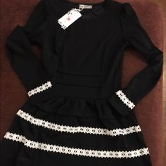 Adorable ruffle dress fully lined. Nwt, never worn. Tag says small but will fir a medium too. Super soft and adorable! Dresses Mini