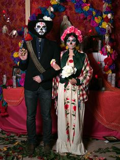 Halloween couple costume. Dia de los muertos. I like the roses in the hair, and the mans hat and bullets
