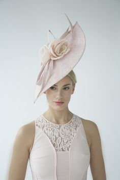 Flower and twists sweeping hat (front view) | Joanne Edwards Millinery | Spring-Summer 2015 | Sinamay hat with handmade silk dupion flowers and coque feathers. Colour: pink, lemon yellow. Secured with a comb and hairband