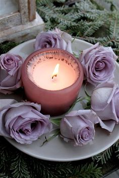<3 pretty candle set up.... i like the color of the roses....reminds me of lavender and lilac...
