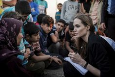 Angelina Jolie visits Syrian border. #UNHCR Special Envoy Angelina Jolie records the stories of #refugees who have just escaped the war in Syria at the Jaber border crossing in #Jordan on 18 June.