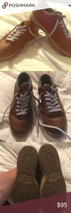 NWOT Nike sneakers Gorgeous brown and purple Nike sneakers! NWOT! These are what they use to call dunks! I also have the brown laces that came with the shoes! They are a size 8.5! The leather is solid brown and laces are a light purple! Nike Shoes Sneakers