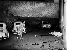 His name was Vincenzo Battaglia and they killed him in the dark, amid the garbage. His wife tried to help him but it was too late. Letizia Battaglia.