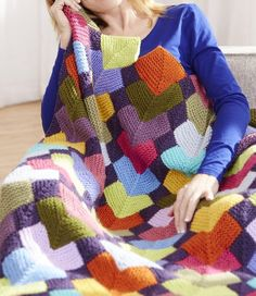 Free Knitting Pattern for Overlapping Squares Afghan - This stashbuster is a variation on mitered squares. Knit in section rows of 7 separate garter stitch pieces. Designed by Irina Poludnenko