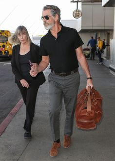 Pierce Brosnan Has Mastered The Old Man Airport Look