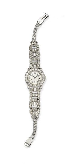 AN ART DECO LADY'S DIAMOND WRISTWATCH The round cream dial with Arabic numerals with blued-steel arrow hands within a circular-cut diamond frame, to the diamond buckle-link bracelet, mechanical movement, mounted in platinum, circa 1925. | Christie's