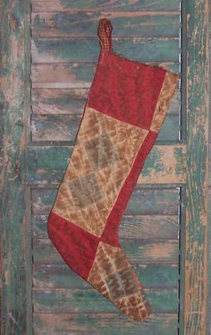Primitive Christmas stocking made from antique quilt. $24 on Etsy.