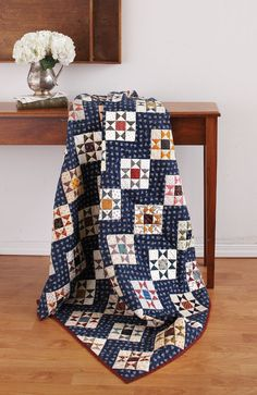 "We love our modern quilts, but Liz Porter's design is testament that traditional quilts continue to inspire. The hourglass units are a snap to make using our ""no triangles"" method. Look for Ohio Star in Fall Scrap '14."