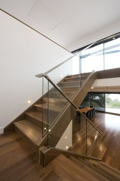 An elegant stair, Mathoura Road brings modern glass balustrade together with stainless steel handrail. Modern Stair Railing, Staircase Handrail, Stair Railing Design, Wooden Staircases, Modern Stairs, Handrail Ideas, Banisters, Staircase Ideas, Spiral Staircases