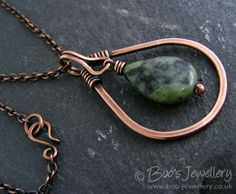 Teardrop shaped hammered and antiqued copper pendant with Chinese green jade teardrop stone dangle.  The integral wrapped loop bail mirrors the teardrop shaped theme.