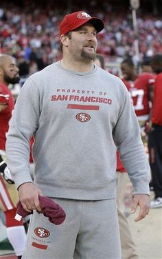San Francisco 49ers defensive tackle Justin Smith walks on the sideline during the fourth quarter of an NFL football game against the Arizona Cardinals in San Francisco, Sunday, Dec. 30, 2012. The 49ers won 27-13. (AP Photo/Marcio Jose Sanchez)