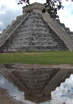 "The Kukulkan Pyramid in Chichen-Itza, known as ""El Castillo"" (the castle), is one of the new seven wonders of the world elected on 07.07.07. Rainy days have their compensations!!"