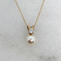 Very pretty faux pearl pendant with cubic zirconia accent. The pendant is long or just under half an inch. The pendant and chain are yellow gold, both stamped The chain is 16 inches long. The necklace weighs grams. Gold Ring Designs, Gold Earrings Designs, Gold Jewellery Design, Pearl Jewelry, Silver Jewelry, Pearl Necklace, Diamond Cross Necklaces, Simple Jewelry, Minimalist Earrings