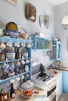 Peter Hone's kitchen, surprisingly free of the classical reliefs that adorn the rest of his home, is Instead styled on bright country kitchen simplicity