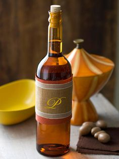 Make a fall wine wrap using fabric scraps and paint. More colorful fall projects: http://www.bhg.com/thanksgiving/crafts/colorful-simple-fall-projects/?socsrc=bhgpin110712fallwinewraps#page=24