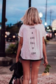 Details Live that love filled life in our Life Full of Love curved hem pocket tee! This tee features a soft and oversized curved hem, scoop neck, in a long body