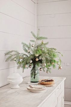 Decorate small branch clippings for a simple holiday arrangement -- such an adorable Christmas DIY idea! Great holiday craft to do with kids and an easy way to use leftover ornaments or decorate an unused corner. Also looks great as an entryway, hallway o Little Christmas Trees, Noel Christmas, Country Christmas, Simple Christmas, Winter Christmas, Vintage Christmas, Christmas Crafts, French Christmas Decor, Christmas Greenery