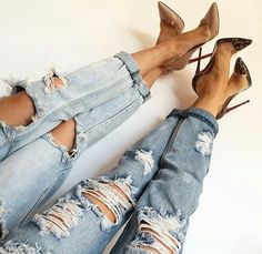 Twinning in boyfriend jeans and pumps.