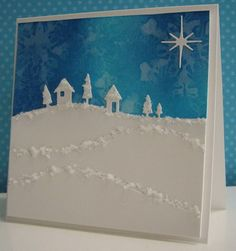 delightful winter scene...luv the chunky white glitter on the top of the hill layers and the interesting things happening in the blue stamped sky!!!