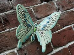 Ceramic butterfly on wall