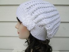Very unique Slouch beanie Winter hat is Great accessory for any time of the year, Dressy and elegant. Knit hat Fits a full size adult head. Has